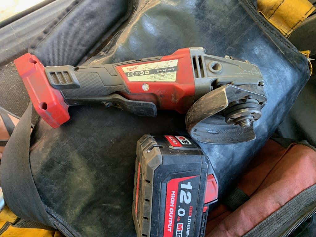 milwaukee-angle-grinder-with-battery-on-bag