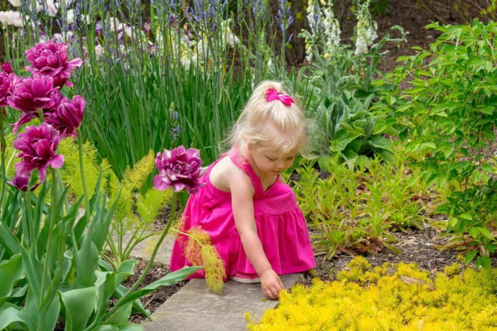 little-girl-exploring-sensory-garden