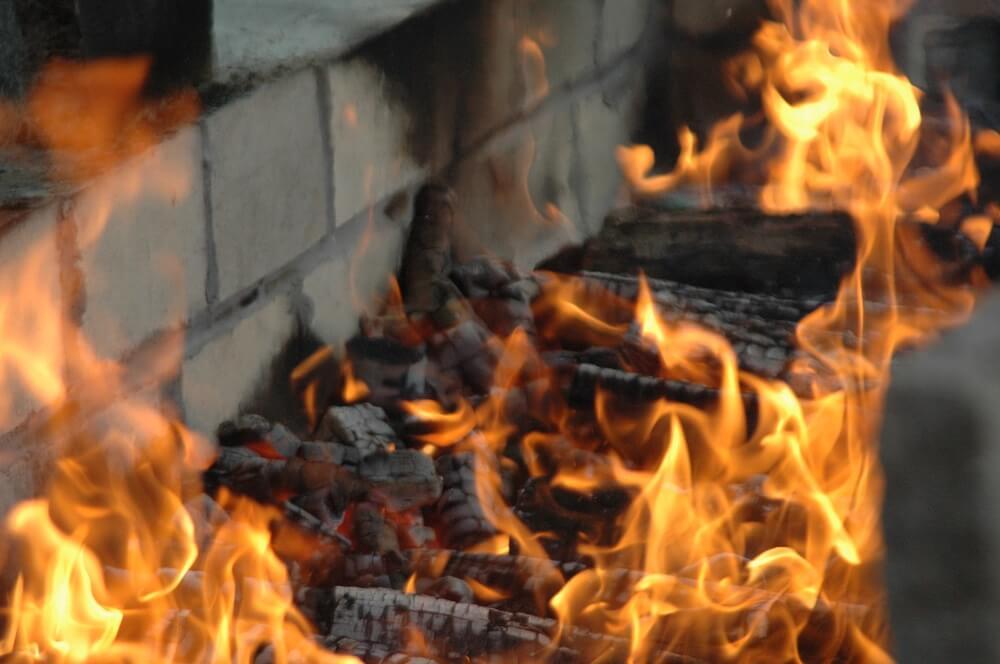 cinder block fire pit backyard fire hot coals