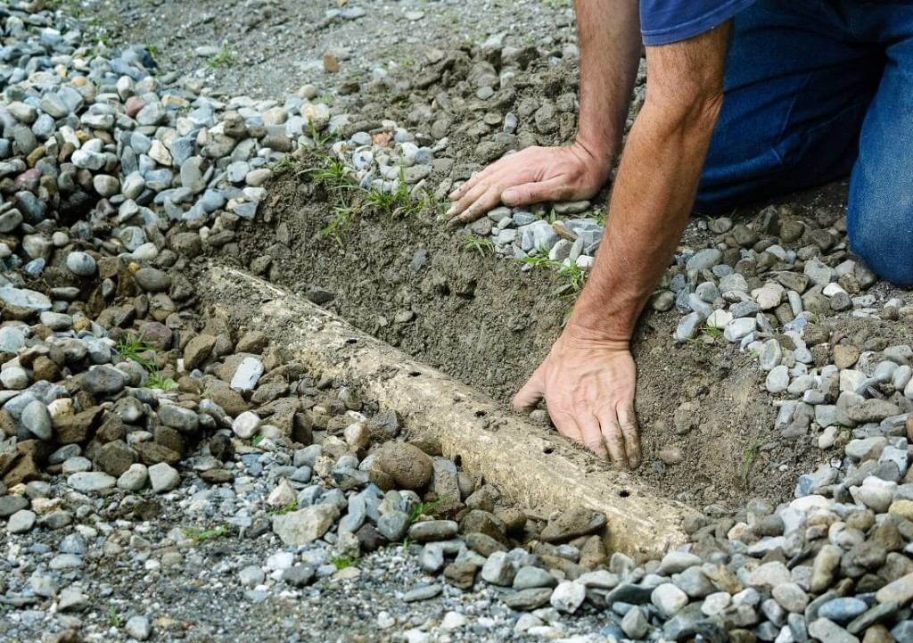 cleaning backyard drainage ditch