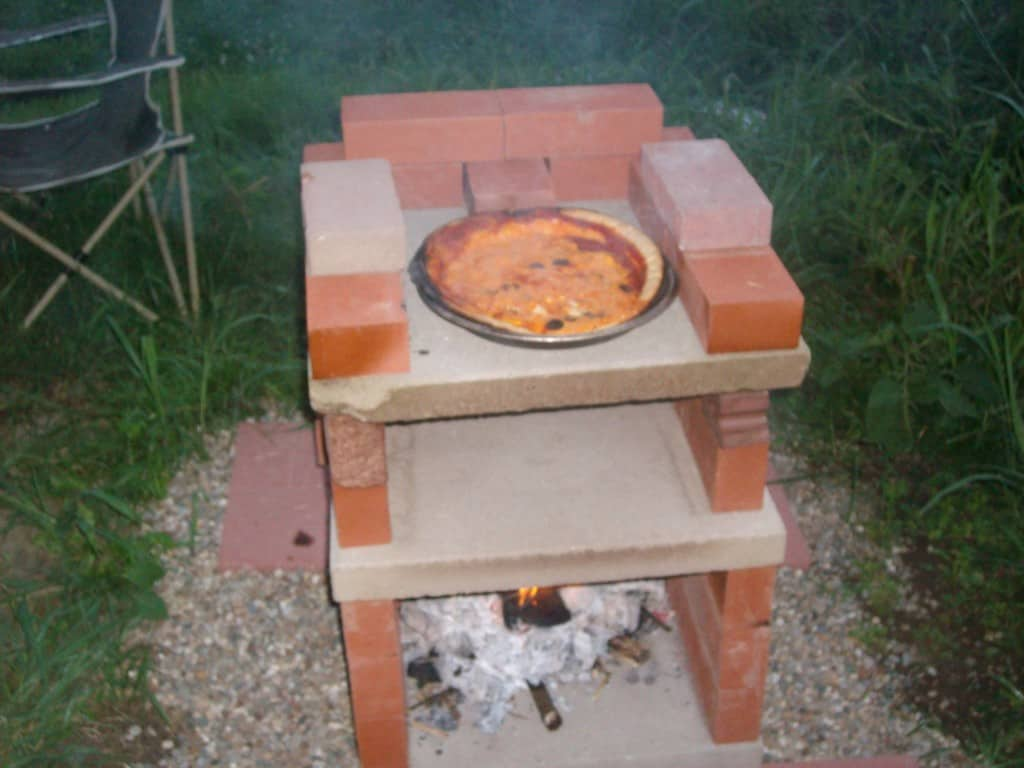 diy-brick-pizza-oven-in-action-with-pizza