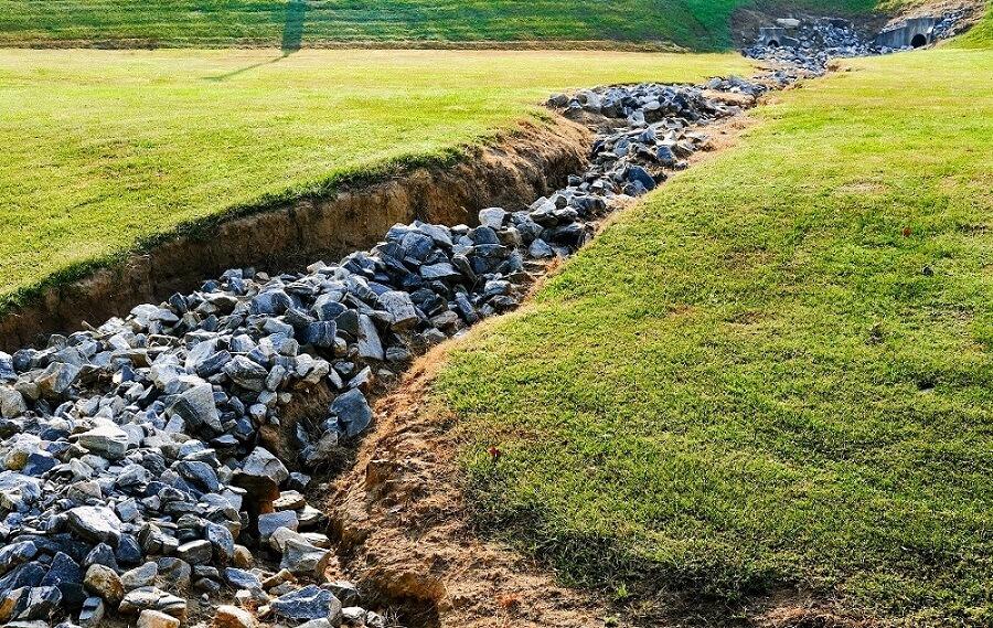 drainage ditch granite rocks landscaping